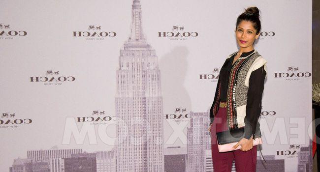 Freida Pinto viste de Hoss Intropia en la inauguración de Coach en Madrid
