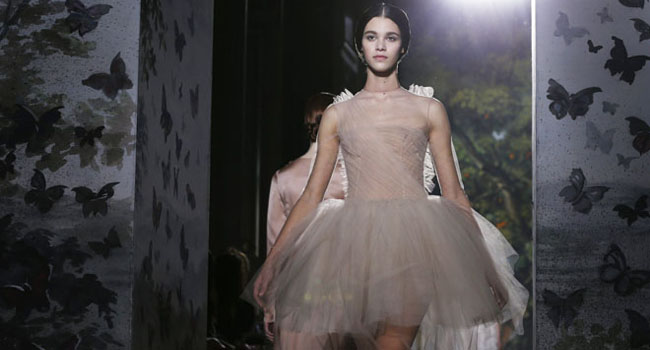 A model presents a creation by Italian designers Maria Grazia Chiuri and Pier Paolo Picciolo as part of their Haute Couture Spring/Summer 2014 fashion collection for fashion house Valentino in Paris